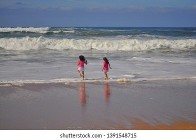 Children playing in the water at Logan Beach, Warrnambool