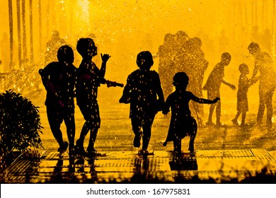 children playing in water - Songkran Festival in Thailand