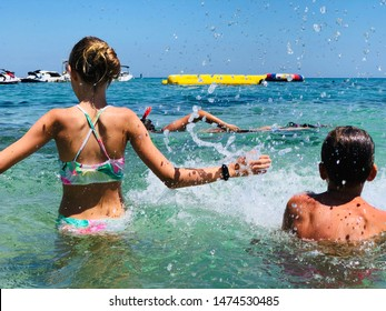 Children are playing in the water, summer water fun. Cyprus beach.
