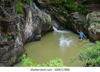 Children playing waterfall in Thai countryside.