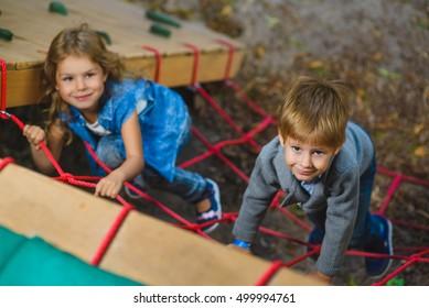 Children playing when having fun doing activities outdoors.