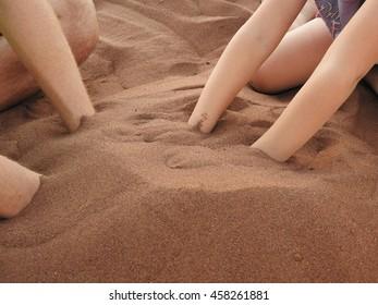 Children playing  whit sand.