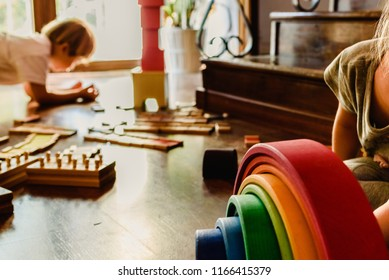 Children playing with wooden rainbow waldorf montessori