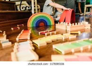 Children playing with wooden rainbow waldorf montessori