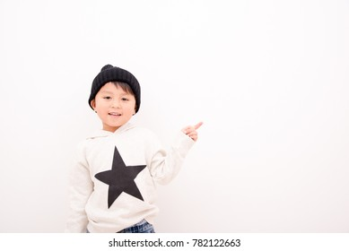Children pointing with a smile