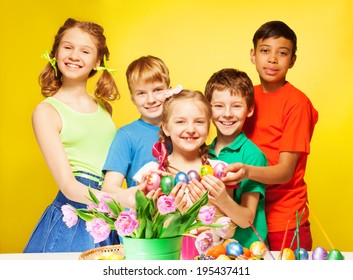 Children portrait who hold Eastern eggs and smile