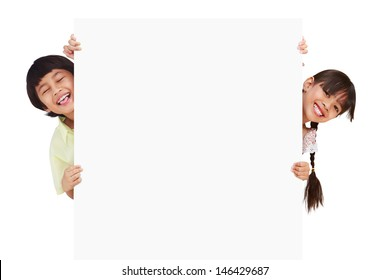 Children posing with a white board, Isolated on white