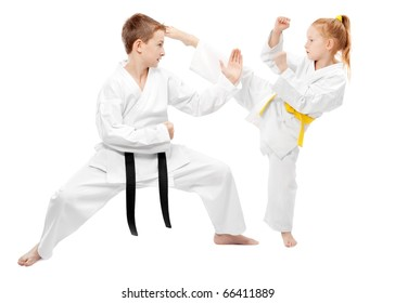 Children practice karate, isolated on white