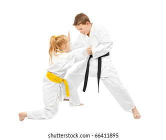 Children practice karate isolated on white