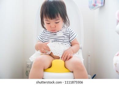 Children practicing toilet
