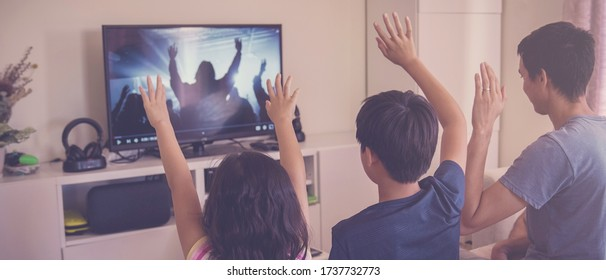 Children praying with father parent , family and kids worship online together at home, streaming church service, social distancing, lockdown concept