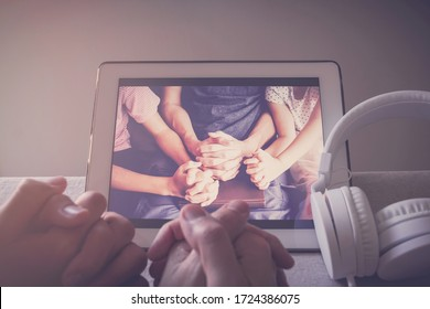 Children praying with father parent with laptop, family and kids worship online together at home, streaming online church service, social distancing concept