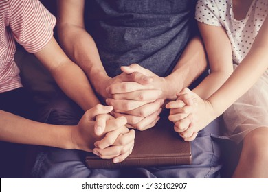 Children praying with their father parent at home, family and kids pray, praying hands, online group worship, World Day of Prayer,international day of prayer, hope, gratitude, thankful, trust concept