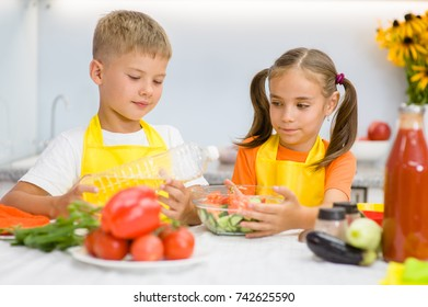 children prepare vegetable salad for lunch