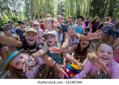 "Children pull hands. Children's camp ""Berezka"". Editorial. Russia. Yaroslavl region. 31.07. 2016"