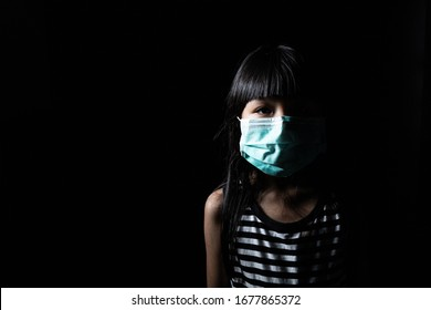 Children put on mouth masks to prevent various viruses such as covid-19 or  Corona viruses entered the body with a black scene. with copy space
