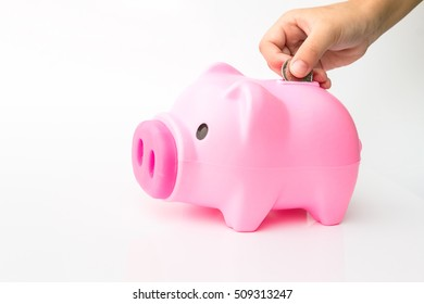 children Putting Coin In Piggy Bank