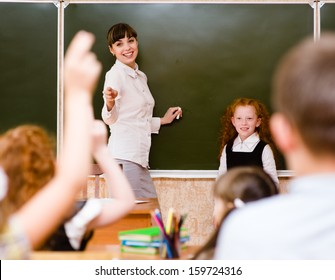Children raising hands knowing the answer to the question