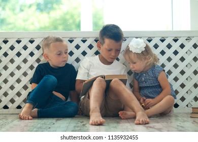 children read a book on the bed