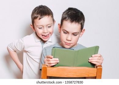 children read an e-book. kids reading a funny book together