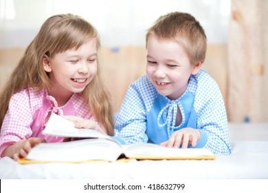 Children reading book.