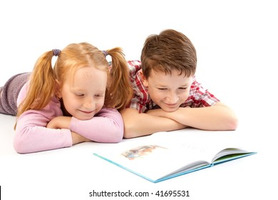 Children reading a book isolated on white background