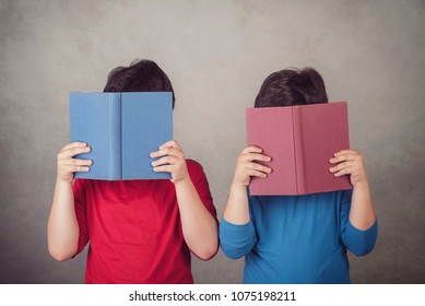 children reading a book on gray background