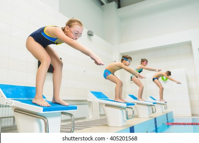 children ready to jump into sport swimming pool. Sporty kids