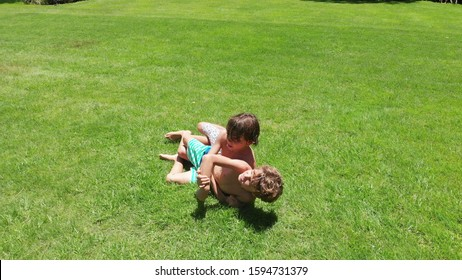 Children real life fighting and wrestling outdoors