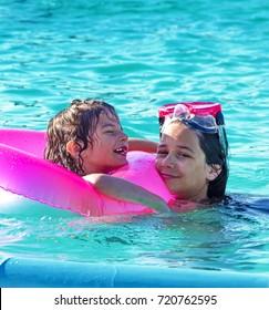 Children rest in the pool in summer