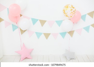 Children room. First birthday party for little girl princess. White interior. balloons and garland in white room. Birthday party for baby. Kinder room. Stylish kid room with decoration