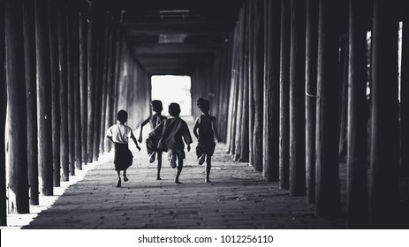 Children runing in the old temple, Salay Bagan Myanmar