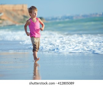 Children Running Along Beach