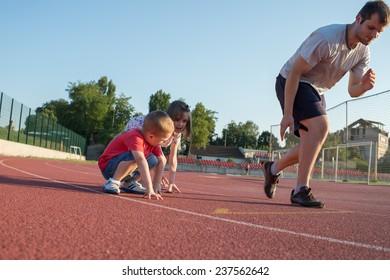 children running on the track