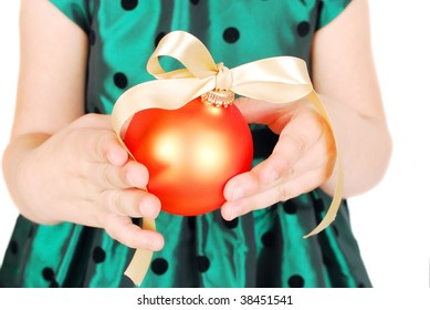 Children s hand Holding a orange  Christmas bauble. Isolated on a white background.