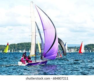 Children Sailing in High  School  Sailing  Championships.  Belmont, Lake Macquarie, New South Wales, Australia.