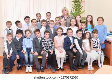 Children at school boards in the classroom lesson. Zelenograd, Russia - December 28, 2018