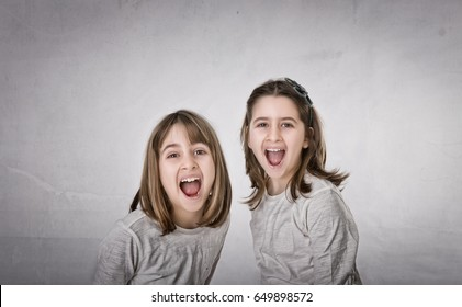 children screaming in frontal pose, light background