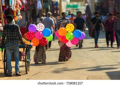 Children sell colorful balloons in Pushkar during Pushkar Camel Fair
