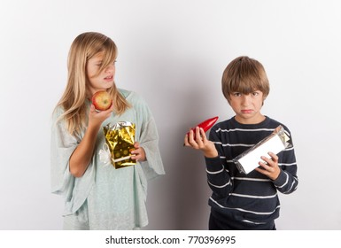 Children shocked by strange gifts. The present boxes contained apple and paprika.