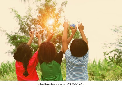 children show hand with light bulb and world toy concept solar energy
