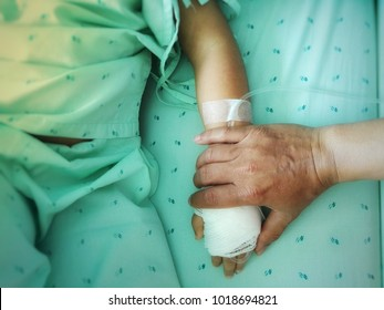 children are sick  make parents unhappy. Hand of the father holding the sick child hand.