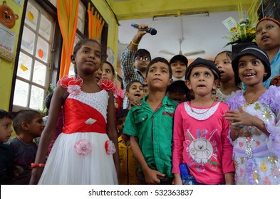 Children singing and dancing.Image taken at an event orgaised for Cancer pateints by an NGO in Mumbai,India.Image date:24th September 2013