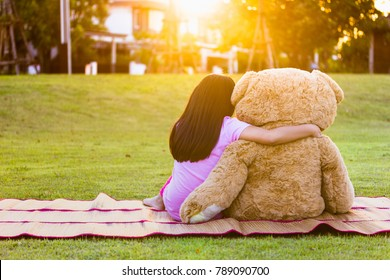 Children sitting and hugging big teddy bear soft toy. Feel love and care. Family Friendship Concept.
