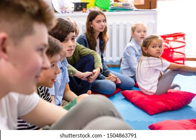 Children sitting on the floor in kindergarten in preschool