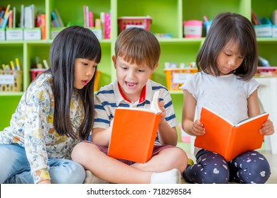Children sitting on floor and reading tale book  in preschool library,Kindergarten school education concept