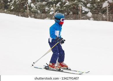 Children skiing under the snow. Winter sport. Ski slope. Horizontal