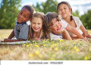 Children smiling and having fun on the grass