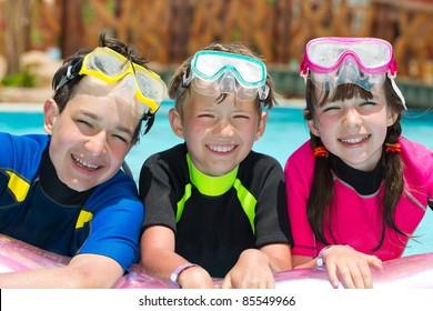 Children snorkeling in pool
