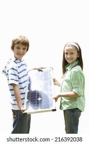 Children with solar panel, smiling, portrait, cut out